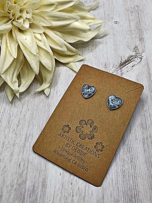 Black and white heart earrings.