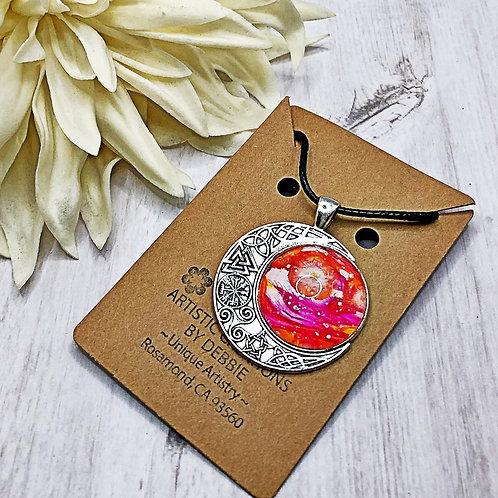 Pink and Orange celtic moon pendant.