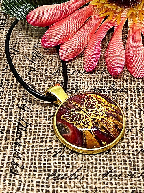 Gold and reddish/brown butterfly pendant