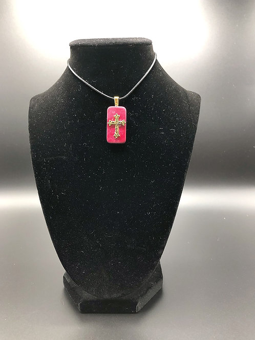 Altered domino pendant.  Reddish pink alcohol ink background with gold cross adhered to front.