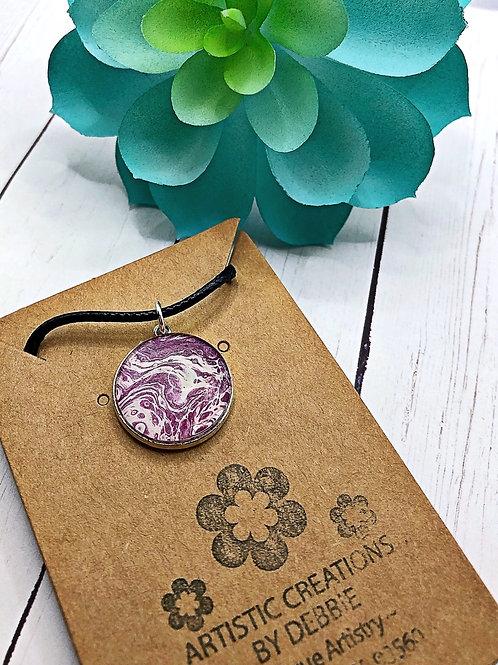 Purple swirl round pendant.
