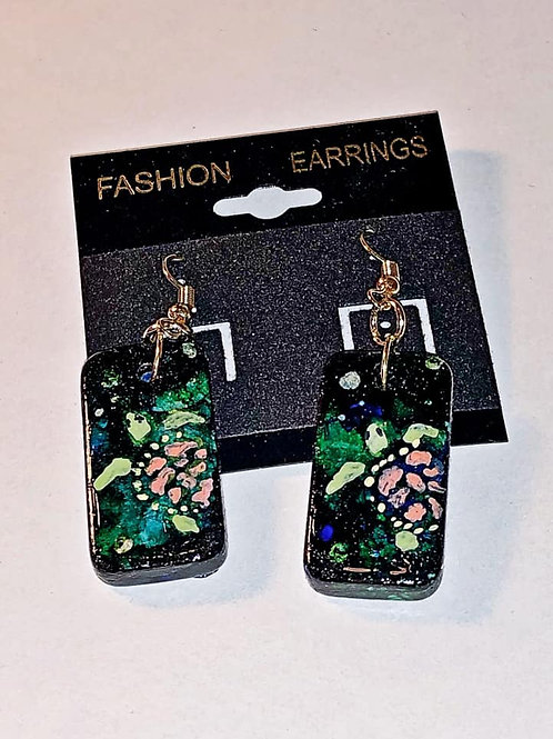 Altered domino earrings.  Blue alcohol ink background with handpainted turtles painted on the front.