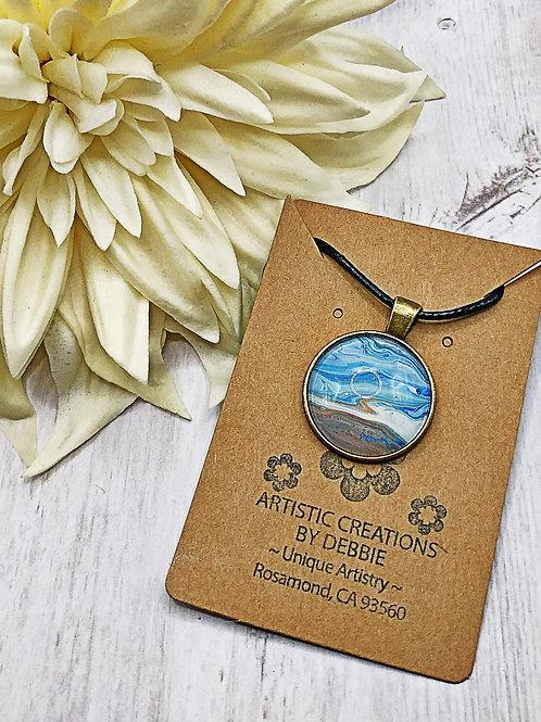 Beach color round pendant.