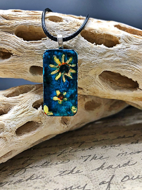 Altered domino pendant.  Blue, teal alcohol ink background with hand painted yellow flowers on the front.