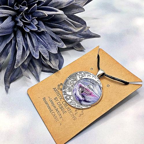 Purple celtic moon pendant.
