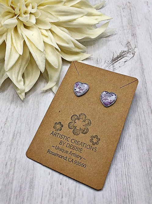 Purple and white swirl heart earrings.