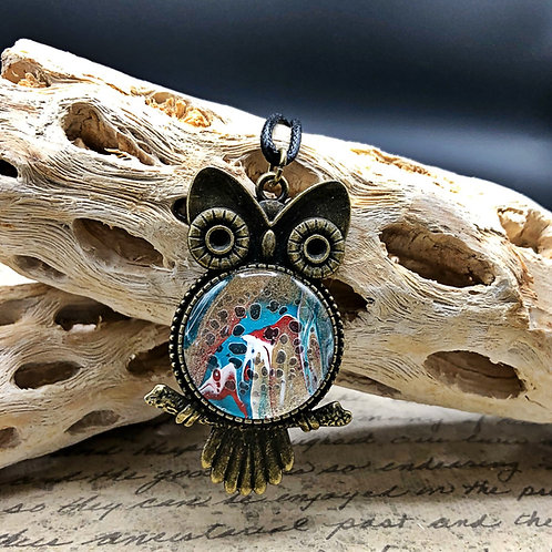 Bronze owl pendant with multi colored  acrylic painted center.