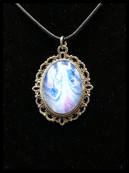Blue and white acrylic pour pendant secured in silver tray.