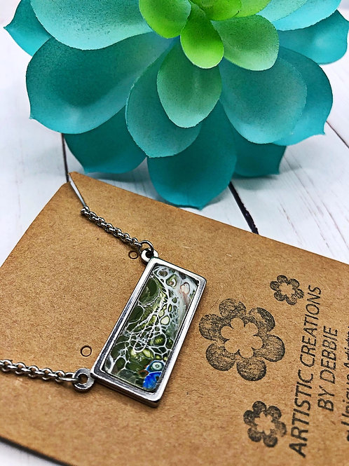 Stainless Steel rectangle pendant/necklace.  Green swirl color.