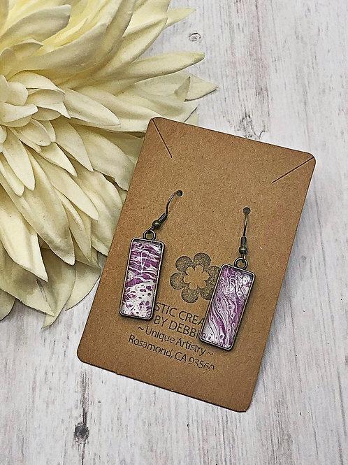 Purple swirl dangle earrings.