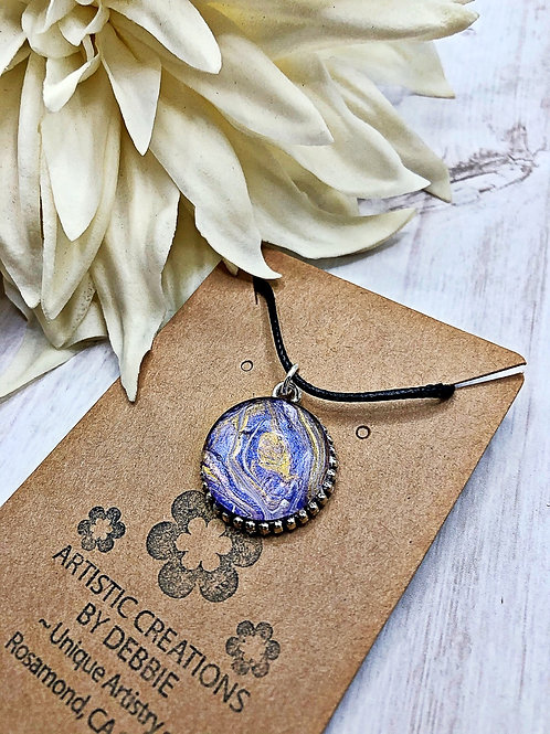Purple and golden color round pendant.