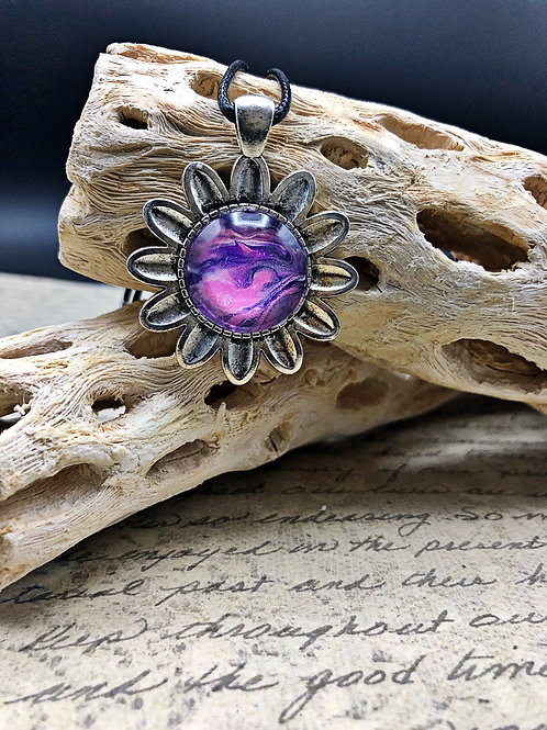 Silver flower pendant with purple acrylic painted center.