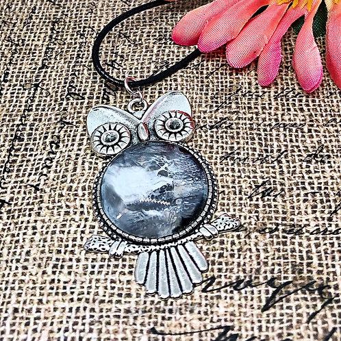 Black and white owl pendant.