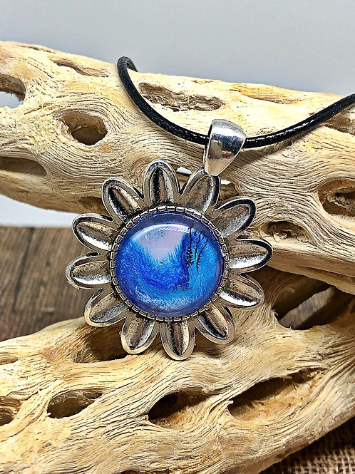 Silver and blue flower pendant