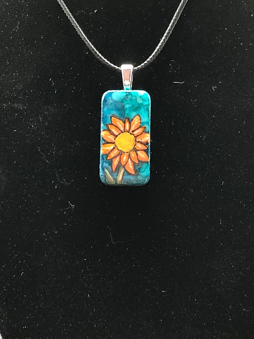 Altered domino pendant.  blue, teal alcohol ink background with handpainted orange flower painted on the front.
