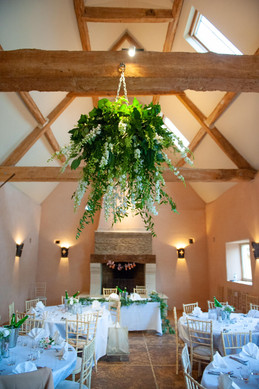 White floral chandelier at Oxleaze Barn