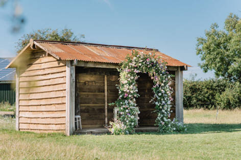 Full floral arch at The Paddock, Oxleaze Barn