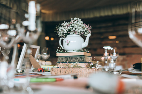 Laura and Ben's teapot table centres.jpg