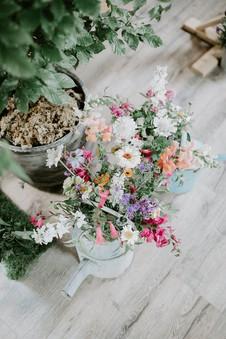 Vintage watering can flowers
