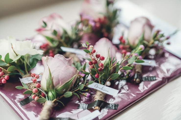 Dusky lilac buttonhole with pink peppercorns