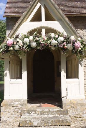 Floral arch over Whelford Chapel door.jp