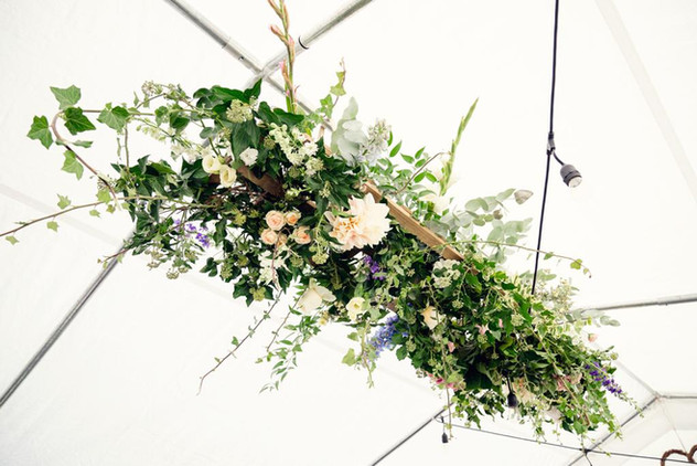 Marquee overhead wedding flowers