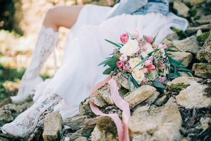 Lace boots and bridal bouquet