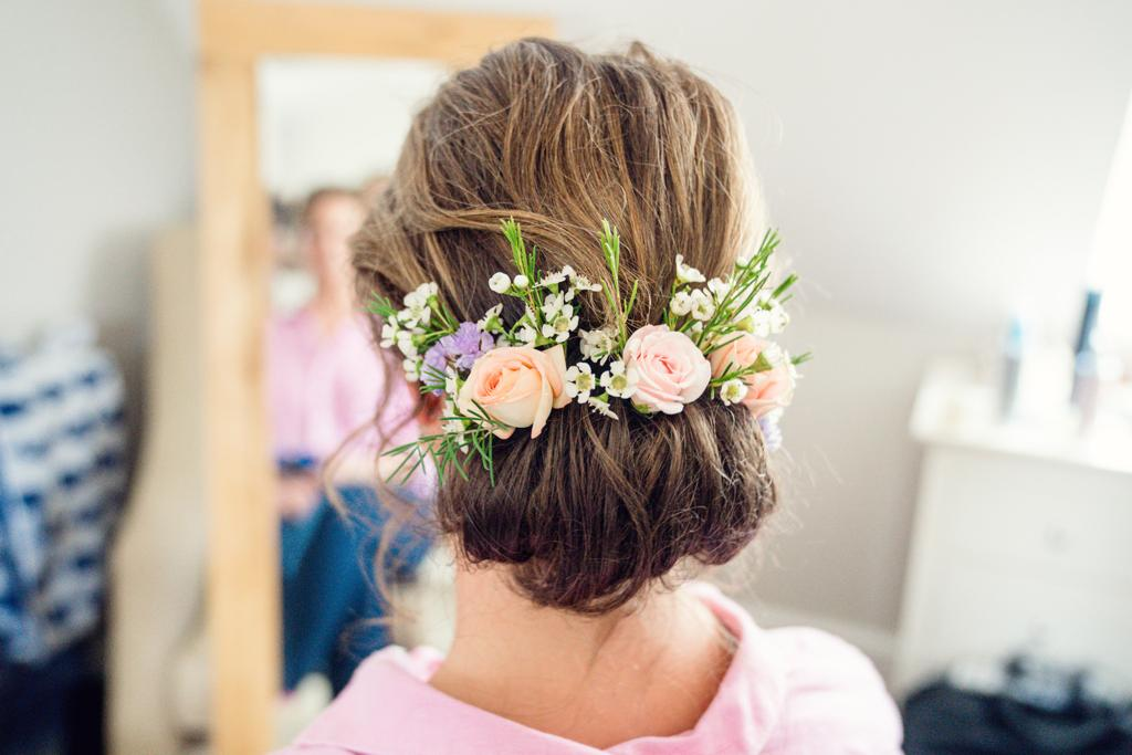 Floral spray across back of head