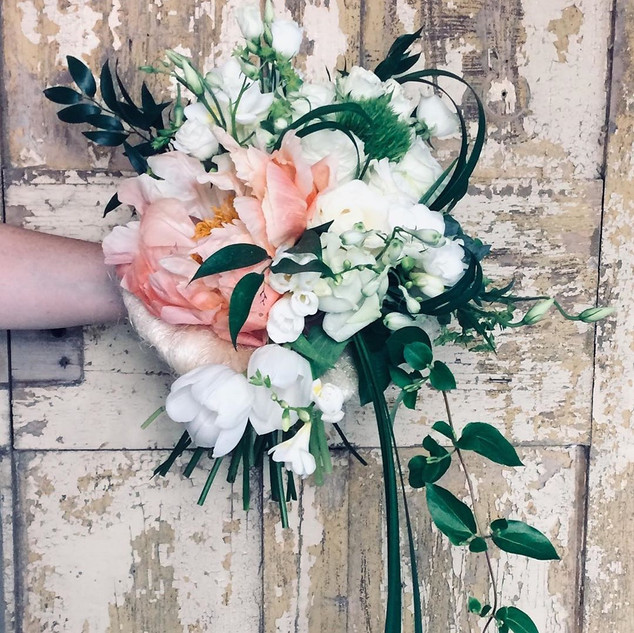 Contemporary coral and white bridal bouquet