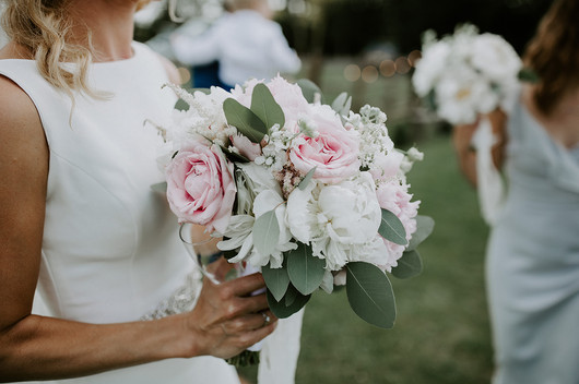 White and pink peony and eucalyptus bridal bouquet