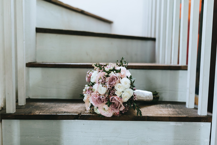 Dusky lilac ranunculus and rose bridal bouquet