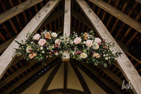 Blush, white and burgundy floral arch