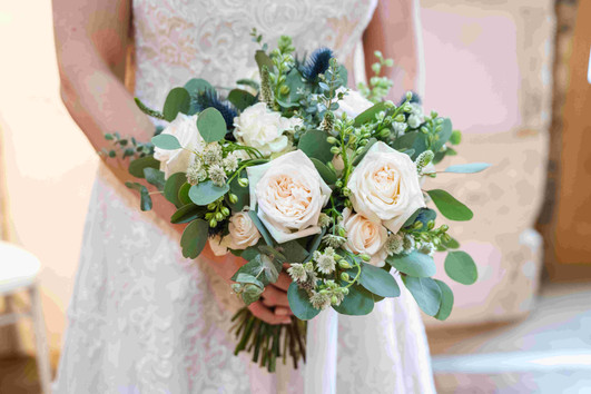 Bridal bouquet with O'Hara Roses and blue thistle bouquet