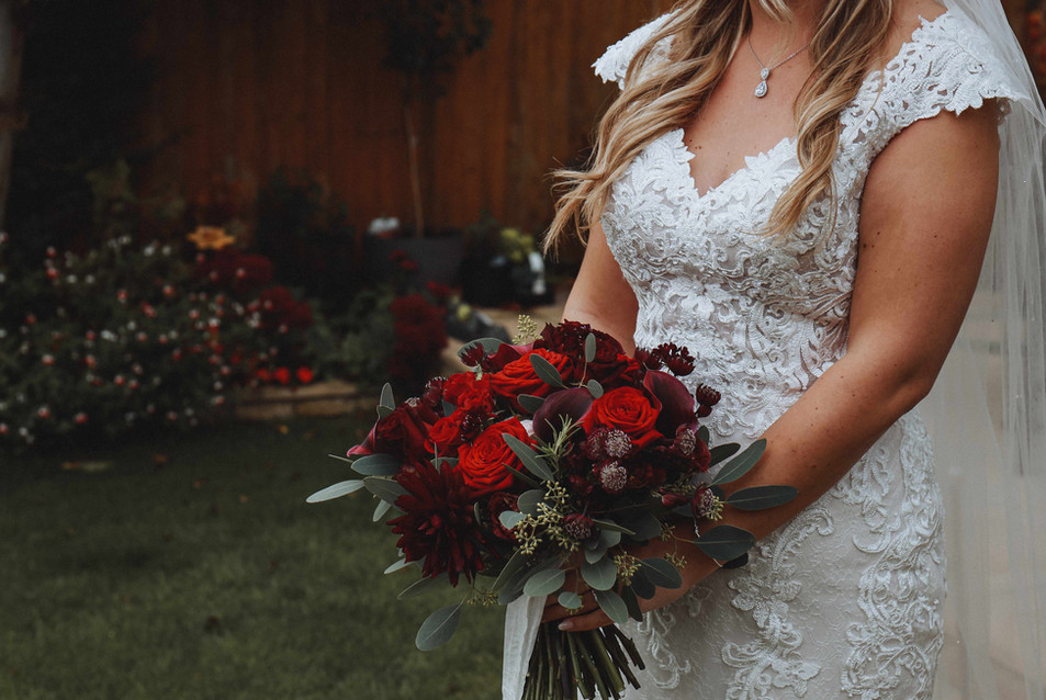 Red rose and calla winter wedding bouquet