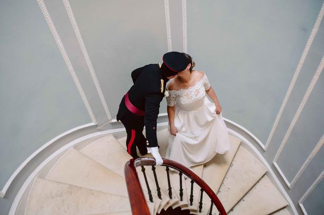 stolen kiss on spiral stair