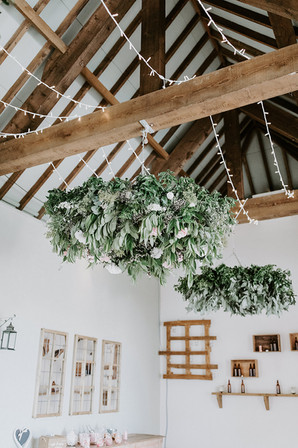 Floral chandeliers at Jenners Barn