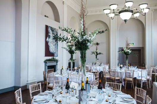 Tall table centres of white delps