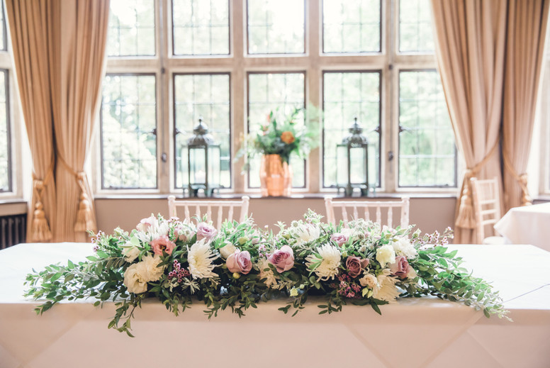 Ceremony and top table flowers in whites and dusky lilac