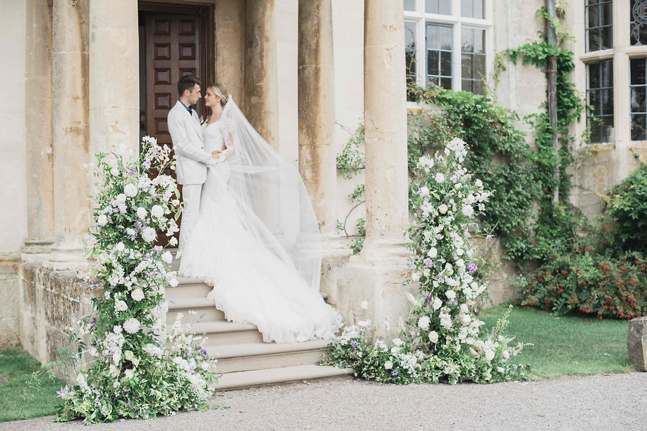 Flower towers at Elmore Court for summer wedding