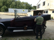 Something different, a 1915 Studebaker came in to get a new cover. Steve is working some magic on it
