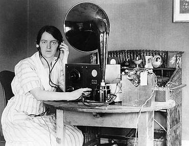 woman-listening-to-radio-in-her-home-everett.jpg