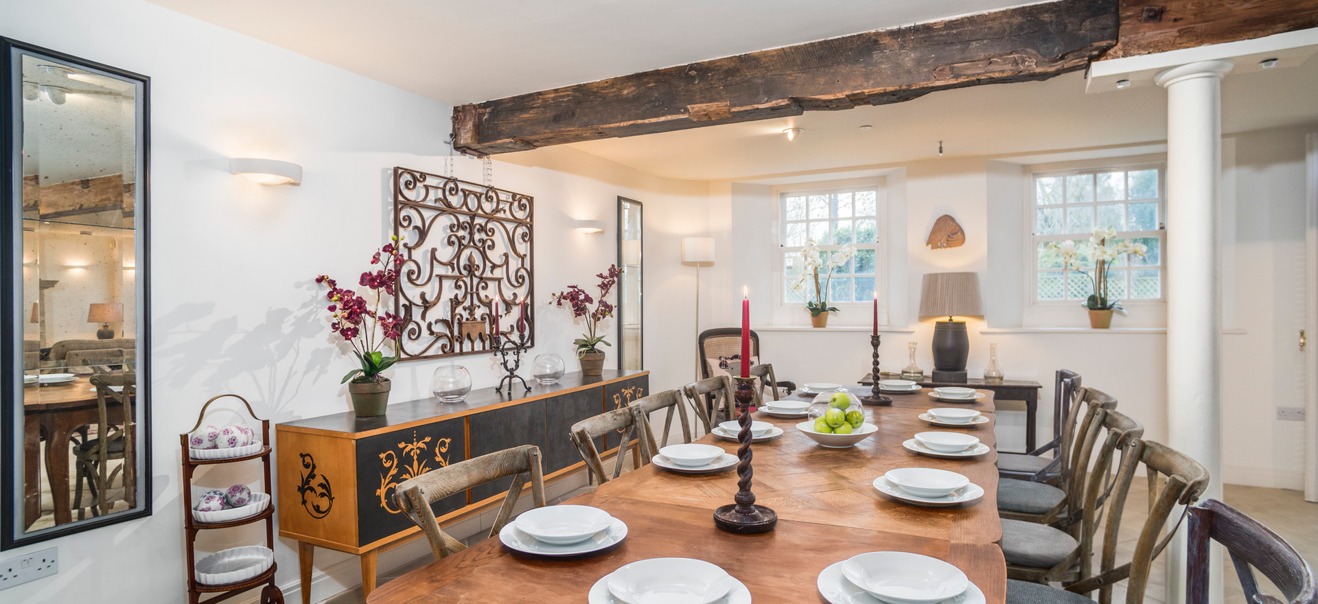 The antique, extending dining table seats up to 16 guests