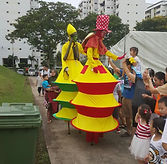 Stilt walker carnival costume fringe activity roving talent entertainment best singapore kids birthday party corporate event company