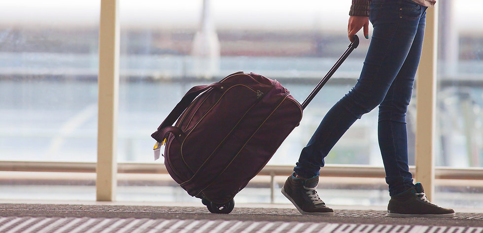 Person Rolling Suitcase in Airport_edite