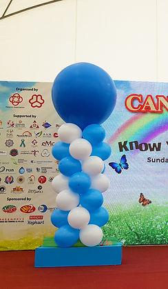 exploding balloon banner raising effect banner rental