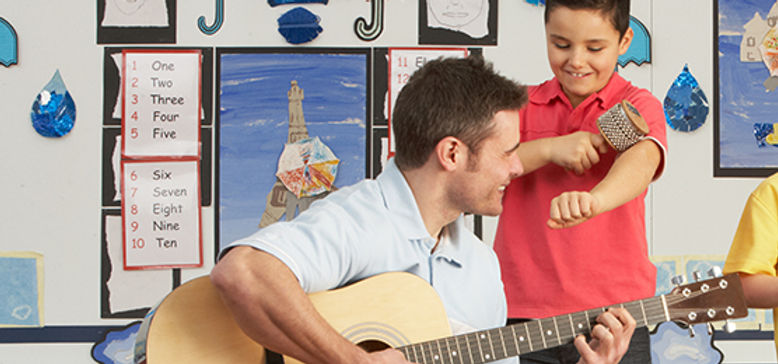 Male Teacher Playing Guitar