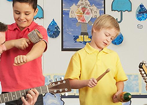 Male Teacher Playing Guitar