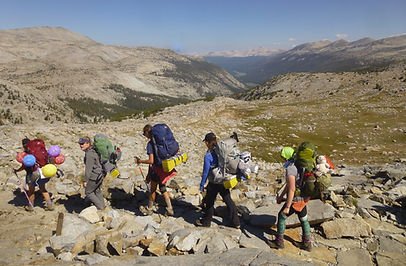 Girl Scouts Backpacking in a Rock Field