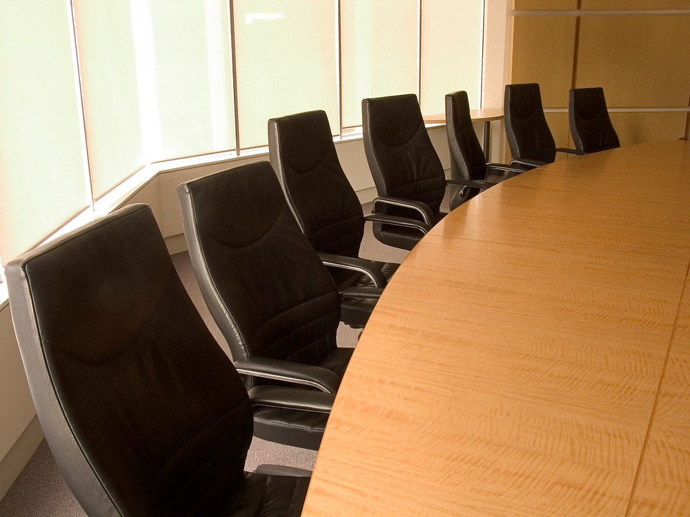 Board Room table with black chairs