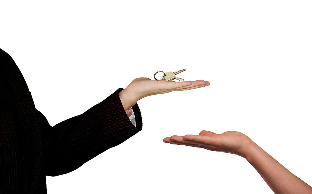 Person handing over keys
